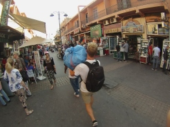 Marching my goods home after a huge day of product buying in Marrakech, Morocco